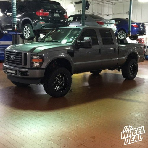 20x10 BMF SOTA Death Metal wheels with 35X12.50R20 Nitto Terra Grappler G2 tires on a 2009 Ford F250