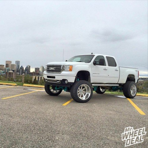 2013 GMC Sierra 2500HD with 24x14 American Force Burnout SS8 Polished wheels and 38x13.50R24 Nitto Trail Grappler tires
