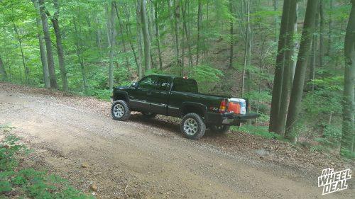 "20x9"" Chrome RBP 94R -12mm wheels with LT35x12.50R20 Atturo Trail Blade MT tires on a 2001 Chevy Silverado 1500"