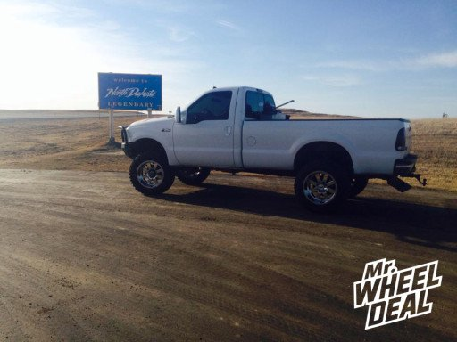 """20x12"""" Moto Metal 962 Chrome Wheels with 35X12.50R20 Nitto Trail Grappler Tires on a 1999 Ford F-350"""