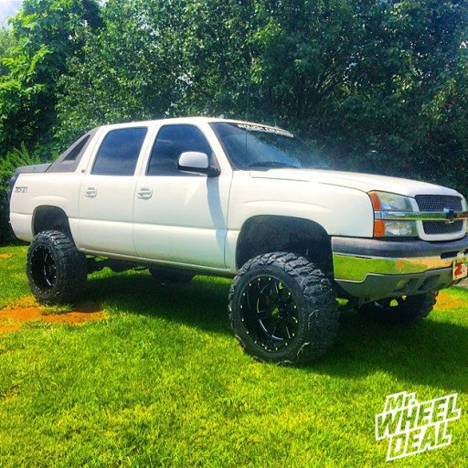 """20x12"""" Moto Metal 962 Black wheels with 35X12.50R20 Nitto Mud Grappler tires on a 2005 Chevy Avalanche 1500"""