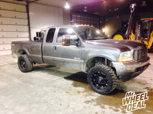 """20x10"""" Fuel Off-Road Hostage Wheels with 33x12.50x20 Nitto Mud Grappler Tires on a 2003 Ford F-250"""