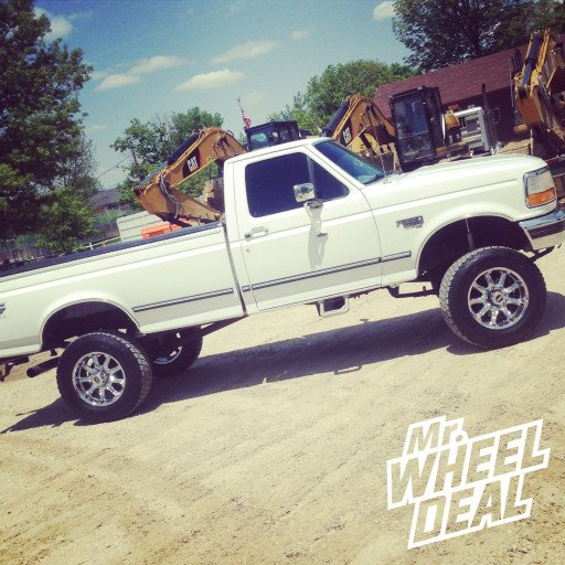 18x9 KMC XD Badlands Chrome Wheels with 285/65/18 Nitto Terra Grappler AT Tires on a 1996 Ford F-250