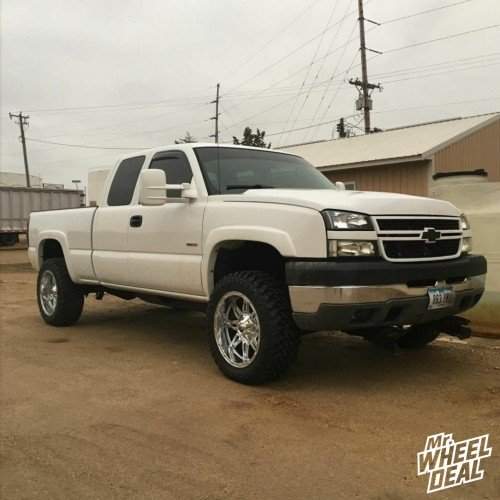 2005 Chevy Silverado 2500 with 20x10 Fuel Off-Road Hostage -24mm wheels and 33x12.50R20 Atturo Trail Blade MT tires