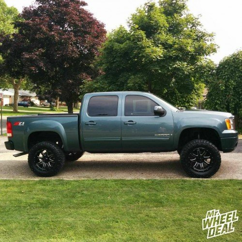"""20x10"""" Black Milled Havok H105 wheels with 295/60/20 Nitto Trail Grappler MT tires on a 2007 GMC Sierra 1500"""