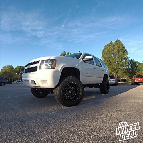 20x12 XD Series Grenade Black Milled wheels with 35x12.50r20 Toyo Open Country ATII tires on a 2007 Chevy Tahoe
