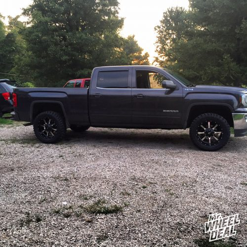 20x9 Moto Metal 970 Black Machined wheels with 33x12.50x20 Toyo Open Country MT tires on a 2016 GMC Sierra 1500