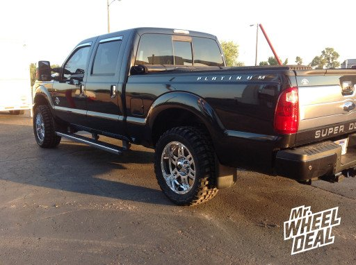 """20x9"""" XD Spy Chrome Wheels with 33x12.50x20 Federal Couragia MT Tires on a 2013 Ford F-250"""