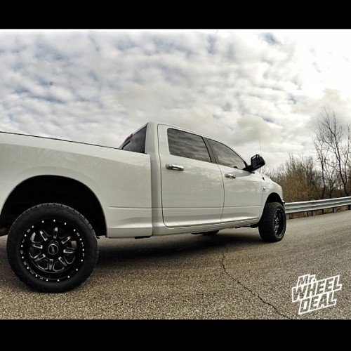 20x10 BMF FITE Death Metal wheels -19 with 305/50/20 Nitto Terra Grappler tires on a 2010 Ram 2500
