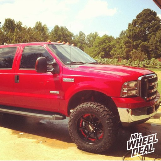 20x10 Moto Metal 961 Black wheels with 35X12.50R20 Nitto Trail Grappler tires on a 2006 Ford F-250