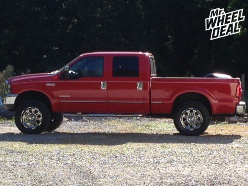 20x10 Hostile Havoc Chrome -19mm wheels with 35X12.50R20 Toyo Open Country MT tires on a 1999 Ford F-250