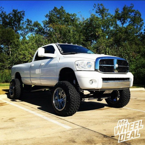"""22x14"""" American Force Octane SS8 Polished wheels with 37x13.50x22 Toyo Open Country MT tires on a 2008 Ram 2500"""