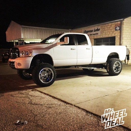 22x14 AF Octane SS8 Polished wheels with 37x13.50x22 Toyo Open Country MT tires on a 2008 Ram 2500
