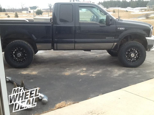 """18x9"""" XD Hoss Gloss Black Wheels with 35x12.50x18 Toyo Open Country AT II Tires on a 2001 Ford F-250"""