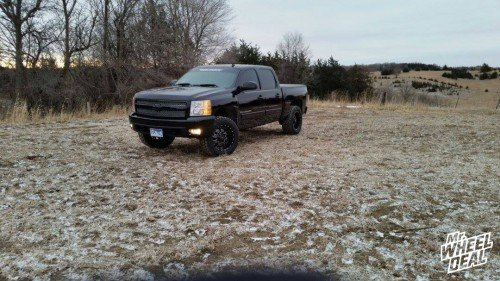 20x10 RBP 89R 0mm wheels with LT305/55/20 Toyo Open Country AT 2 tires on a 2008 Chevy 1500