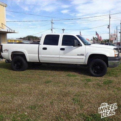 """18x9"""" XD811 Rockstar II Black wheels 0mm wheels with 305/60/18 Mickey Thompson ATZP3 tires on a 2005 Chevy Silverado 2500HD"""