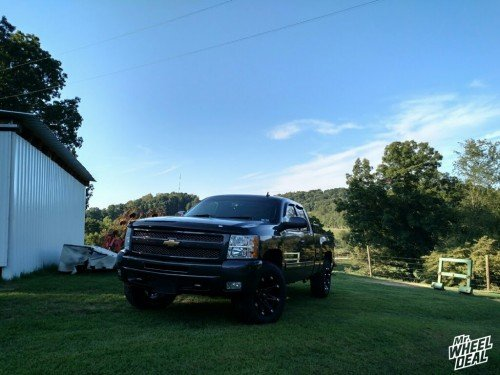 """18x9"""" Ballistic Jester Black wheels with LT275/70/18 General Grabber AT2 tires on a 2010 Chevy Silverado 1500"""