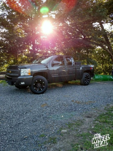 18x9 Ballistic Jester Black wheels with LT275/70/18 General Grabber AT2 tires on a 2010 Chevy Silverado 1500