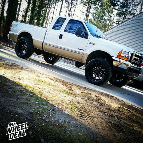 """22x10"""" Black Milled Fuel Off-Road Maverick wheels with 35X12.50R22 Toyo Open Country MT tires on a 2000 Ford F-250"""