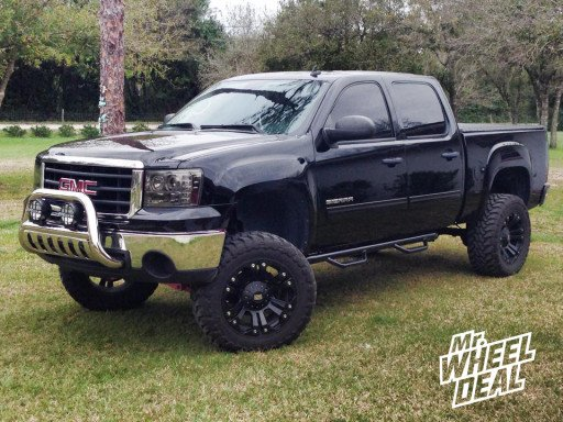 """20x10"""" XD Monster Black Wheels with LT35x12.50x20 Toyo Open Country MT Tires on a 2011 GMC Sierra 1500"""