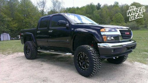 18x9 Moto Metal 962 Black Wheels with LT285/65/18 Nitto Trail Grappler Tires on a 2009 GMC Canyon