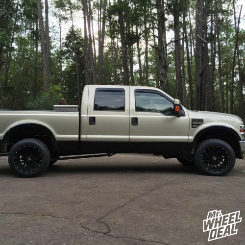 """20x12"""" KMC XD 820 Grenade Black wheels with 305/50R20XL Nitto 420S tires on a 2009 Ford F-250"""