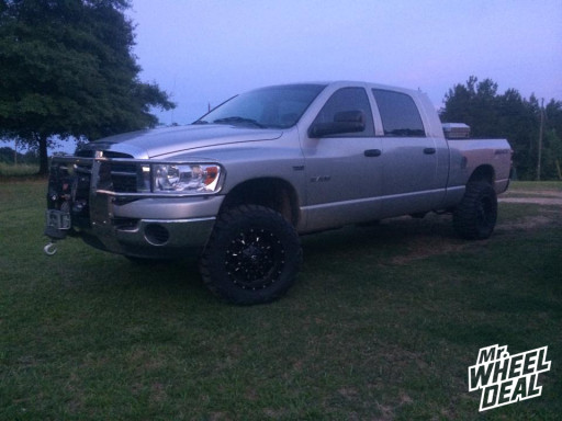 18x9 Fuel Offroad Krank Wheels with 33X12.50R18 Nitto Mud Grappler Tires on a 2008 Ram 1500