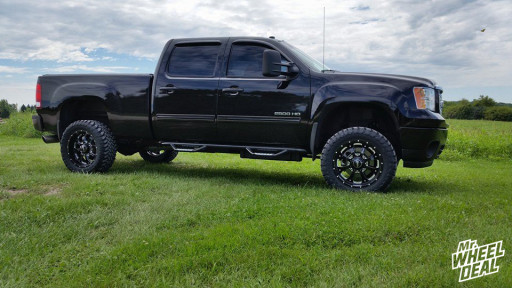 "20"" Novakane Death Metal Black wheels with 33"" Toyo Open Country MT tires on a 2013 GMC Sierra 2500HD"