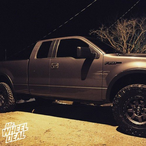 """18x9"""" Fuel Trophy wheels +20 offset with LT295/70/18 Nitto Trail Grappler tires on a 2005 Ford F-150"""
