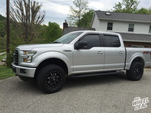 18x9 Black Milled Fuel Off-Road Krank +14mm wheels with 285-65-18 Toyo Open Country AT II tires on a Ford F-150