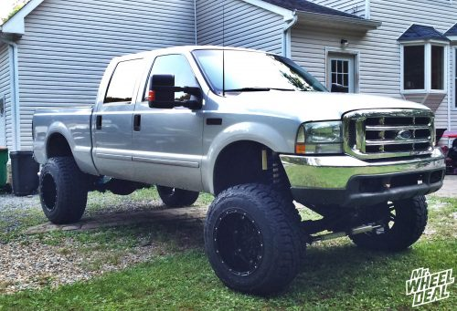 """20x14"""" Fuel Hostage Black wheels with 37x13.50R20 Toyo Open Country RT tires on a 2003 Ford F-250"""