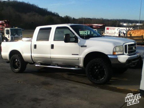 20x9 BMF Novakane Stealth +0 wheels with LT305/55/20 Nitto Trail Grappler tires on a 2002 Ford F250