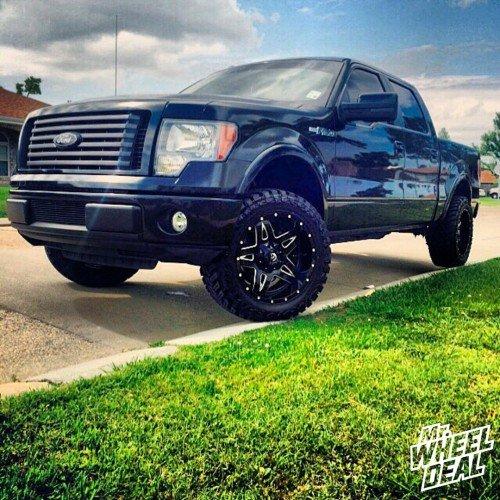 20x10 Fuel Off-Road Full Blown -12mm wheels with 33x12.50r20 Atturo Trail Blade MT tires on a 2010 Ford F-150