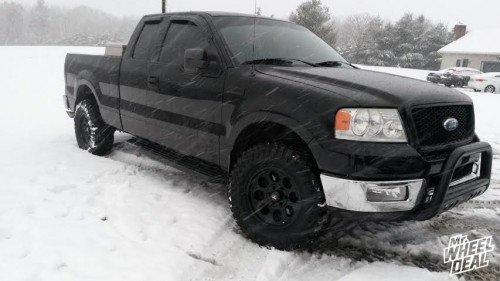 "17x7.5"" Black Level 8 Tracker wheels with 33X12.50R17 Atturo Trail Blade MT tires on a 2004 Ford F-150"
