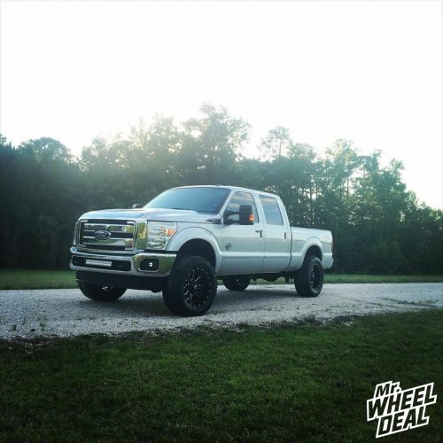 Black Milled 20x10 Fuel Off-Road Maverick wheels with 35x12.50R20LT Nitto Terra Grappler G2 tires on a 2012 Ford F-250