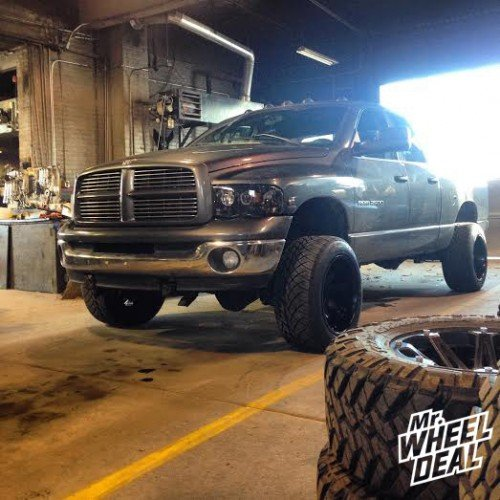 20x12 Fuel Octane wheels with 305/50/20 NT420S tires on a 2004 RAM 2500