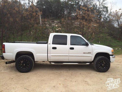 """18x9"""" Moto Metal 962 Black wheels +0 with 285/65/18 Nitto Trail Grappler MT tires on a 2003 GMC Sierra 2500"""
