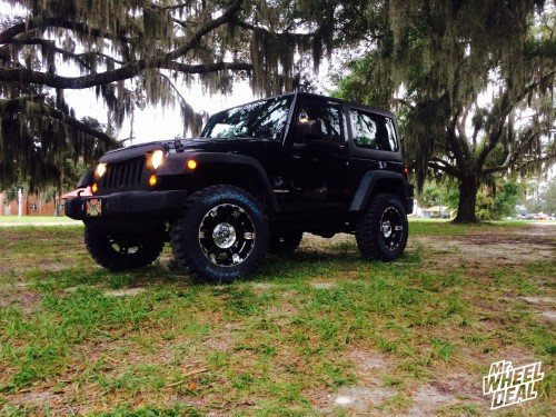 """18x9"""" XD Spy Gloss Black Machined wheels with LT275/65/18 Federal Couragia MT tires on a 2011 Jeep Wrangler"""