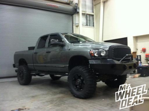 "18x9"" XD Rockstar Black Wheels with 37x13.50x18 Nitto Mud Grappler Tires on a 2007 Ram 2500"