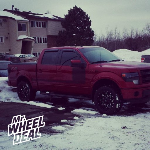 """20x9"""" Fuel Off-Road Lethal Black Milled Wheels with 305-50-20 Toyo Open Country AT II Tires on a 2013 Ford F-150"""