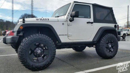 """17x9 KMC XD Rockstar wheels with 35X12.50R17 Nitto Trail Grappler tires on a 2015 Jeep Wrangler Sport with a 3.5"""" Lift"""