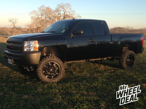 """20x10"""" Fuel Off-Road Hostage Wheels with 33x12.50x20 Nitto Mud Grappler Tires on a 2013 Chevy Silverado 1500"""