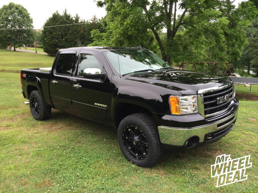 2011 GMC 1500 with 20x9 Fuel Hostage Wheels with 275/60/20 Toyo AT II Tires