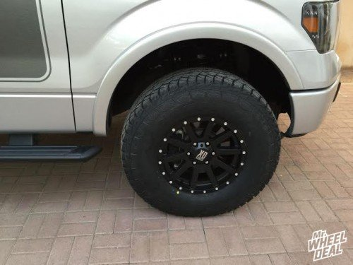 17x9 KMC XD Heist wheels with 315/70/17 Falken Wild Peak AT tires on a 2013 Ford F-150