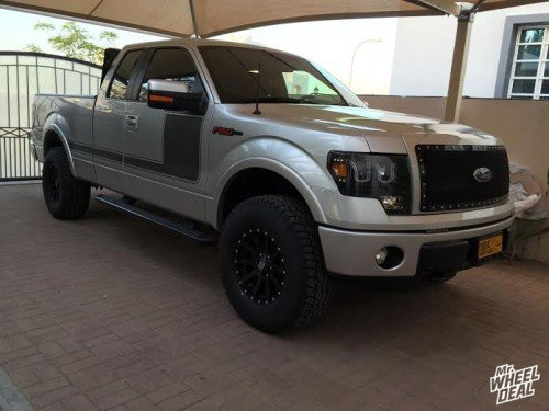 2013 Ford F-150 with 17x9 XD Heist wheels with 315/70/17 Falken Wild Peak AT tires