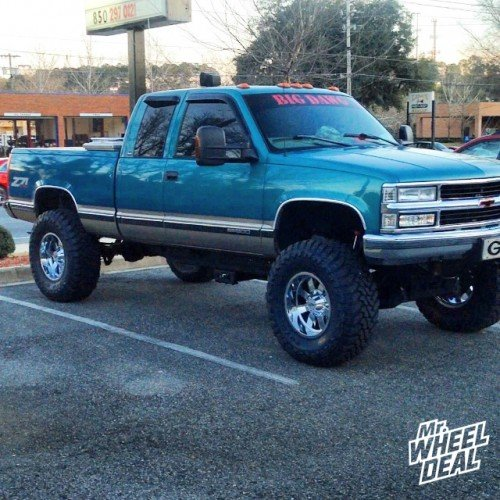 18x10 Moto Metal 962 -24mm Chrome wheels with 38x13.50x18 Toyo Open Country M/T tires on a 1998 K-1500