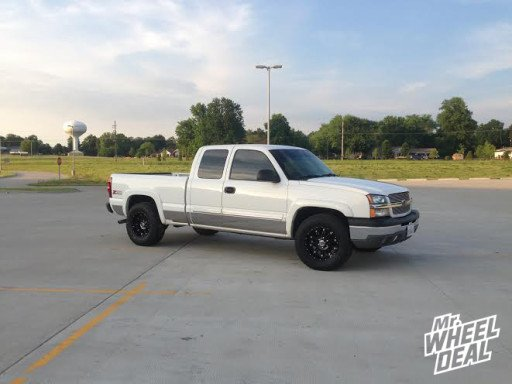 """18x9"""" XD Hoss Black Wheels with 285/65/18 Toyo Open Country AT 2 on a 2004 Chevy 1500"""
