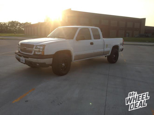18x9 XD Hoss Black Wheels with 285/65/18 Toyo Open Country AT 2 on a 2004 Chevy