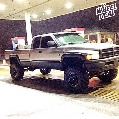 18x9 Black XD Series Addict -12 offset wheels with 37x13.50x18 Toyo Open Country MT tires on a 2001 Ram 2500