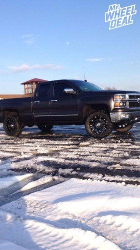"""20x9"""" XD Hoss Gloss Black wheels with 33x12.50x20 Federal Couragia MT tires on a 2014 Chevy Silverado 1500"""